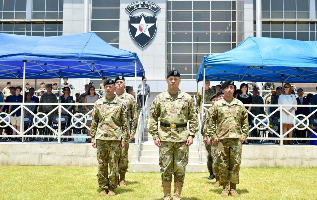 july 2018 15 Maj. Gen. D. Scott McKean, commanding general, 2nd Infantry Division ROK-U.S Combined Division stands with outgoing (left) Brig. Gen. Jonathan E.
