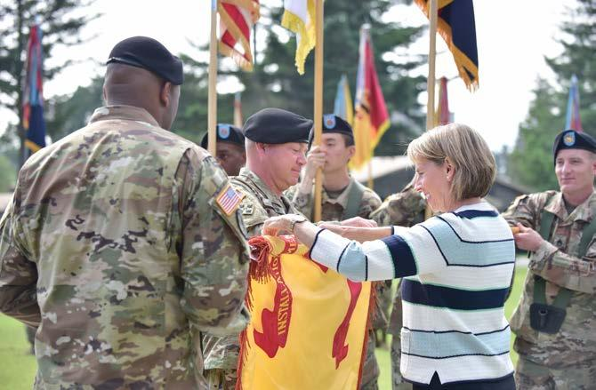 Pak, Chin U., 2ID/RUCD Public Affairs) (Left) Col. Brandon D. Newton, U.S. Army Garrison Camp Red Cloud and Area I commander presents the colors to the reviewing officer, Dr.