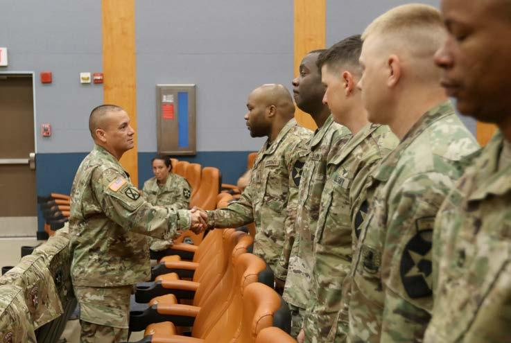 july 2018 9 (Left) Honor graduate Staff Sgt. David K. Arnold, an operations noncommissioned officer presents a Certificate of Appreciation on behalf on the graduating class to guest speaker Sgt. Maj.